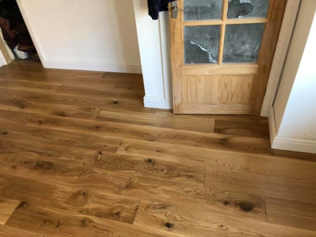 20mm Engineered Oak fitted. Finished off with new skirting boards.