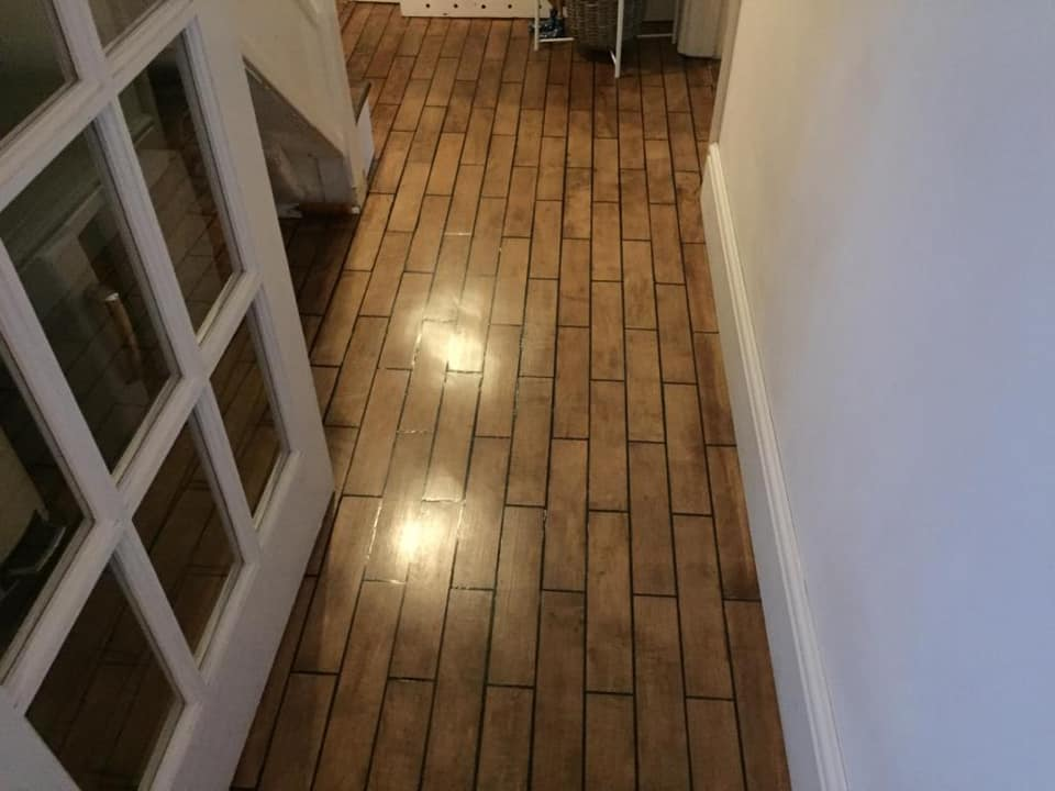 Maple overlays fitted in brick fashion. Sanded, stained and finished with 3 coats of Junckers strong premium