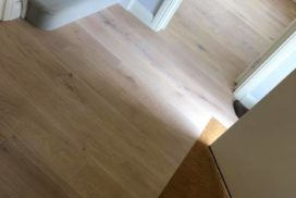 Solid Oak flooring glued directly to the subfloor.